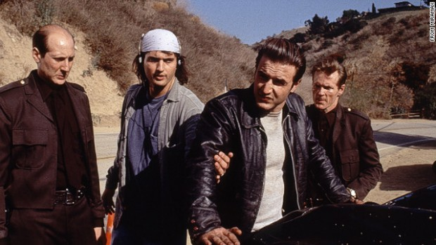 "Robert Rodriguez (center left) and David Arquette (center right) on the set of the grindhouse cinema homage ""Roadracers."""